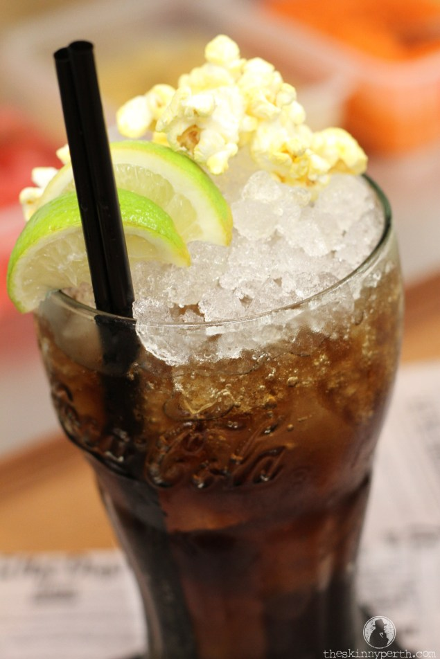 La Premier: Popcorn Washed Rum + Coca Cola + Fresh Lime,  Served In A Classic Coke Glass With A Side Of Popcorn Just Like At The Movies