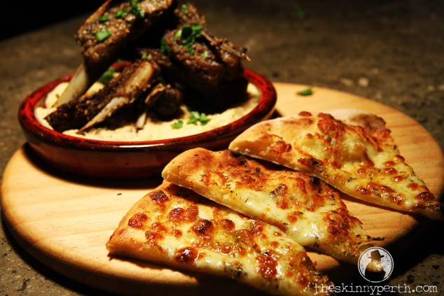 Slow Cooked Lamb Ribs With Hummus & Cheesy Pizza Bread: Middle Eastern Meets Italian In Spectacular Fashion