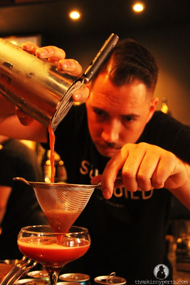 Talmage Hard At Work Whipping Up Some Cocktail Magic